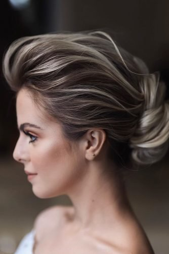swept back wedding hairstyles low rolled updo on medium hair tonyastylist