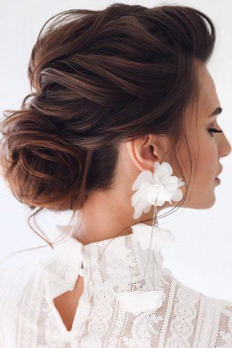 swept back wedding hairstyles textured airy low bun on dark hair tonyastylist