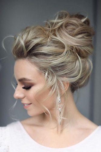 swept back wedding hairstyles textured high bun on blonde hair medium lenth tonyastylist