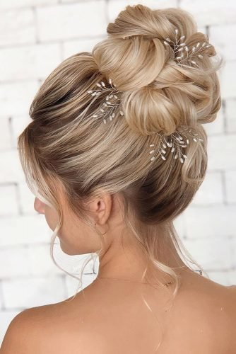 swept back wedding hairstyles volume high bun on blonde hair michellmarcalhair