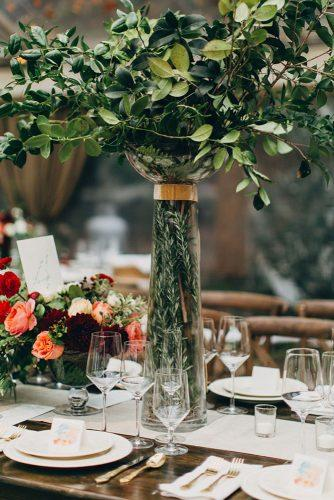 tall wedding centerpieces herbal vase with green leaves amber gress via instagram