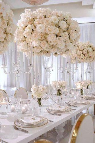 tall wedding centerpieces lush bouquet with white roses in tall transparent vases renezadoriphotography via instagram