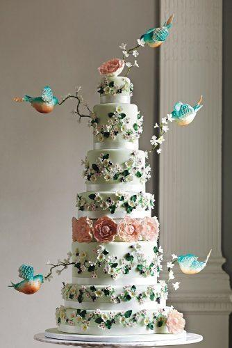 unique wedding cakes tall fairy tale with flowers and birds tuck box