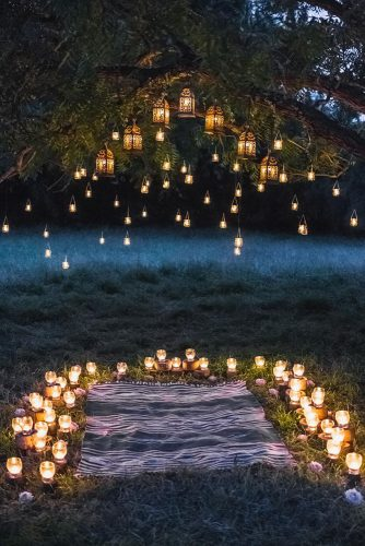 wedding altar decoration altar with carpet and candles under the branches of trees decorated with flowers oleg breslavcev
