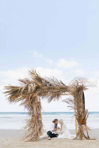 wedding altar decoration arch on the beach of dry palm leaves lyss via instagram