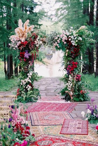 wedding altar decoration boho arch with flowers and chandelier in the aisle lay carpets lev_chudov via instagram