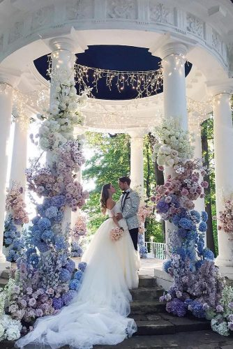 wedding altar decoration gazebo white decorated with blue and pink flowers alenakubik via instagram