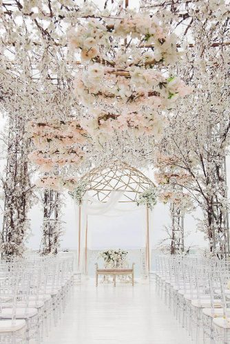 wedding altar decoration gold gazebo at the end of the passage under the air pavilion of flowers designmill via instagram