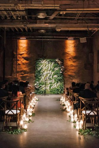 wedding altar decoration in a dark room an altar with a green background and a romantic golden inscription passage gleams from candles mango studios via instagram