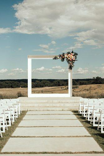wedding altar decoration outdoor ceremony white square altar decorated with flowers bethany jeffery photography