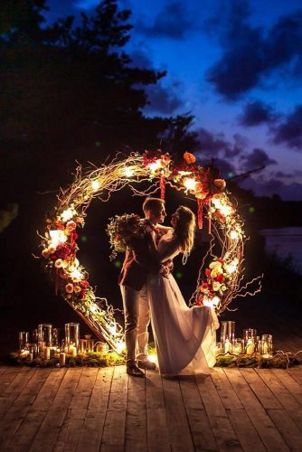 wedding altar decoration round background of branches with glowing lights and flowers michail filimonov via instagram