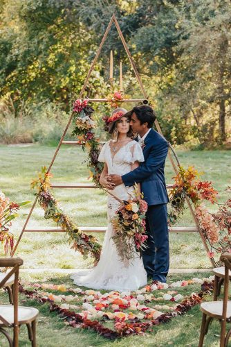 wedding altar decoration the bride and groom on the background of the woodland with flowers and candles carololiva_photography via instagram