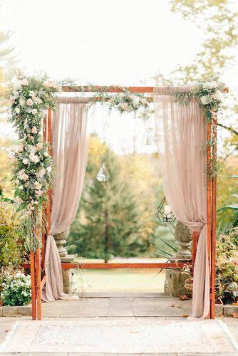 wedding altar decoration the wooden romantic arch is decorated with soft pink fabrics and white flowers elizabeth fogarty