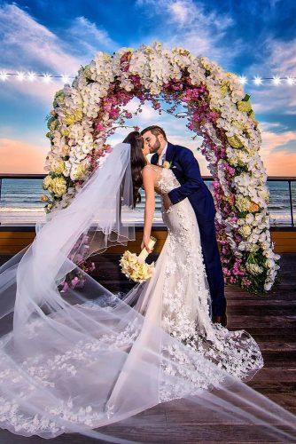 wedding arch decoration ideas bright exotic flowers and white orchid decor adamoprisphotography