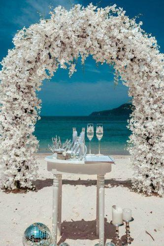 wedding arch decoration ideas with white flowers on the beach phuketwed