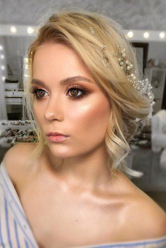 wedding hair and makeup natural blonde updo with front loose curls and pearls tatianawladi