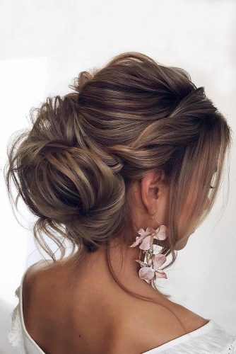 wedding hairstyles for medium hair low updo with braid texture tonya pushkareva via instagram