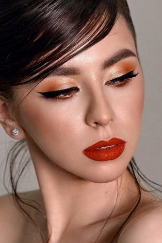 wedding makeup for brunettes gold eyeshadows with arrows and red lips galina_gutmanova