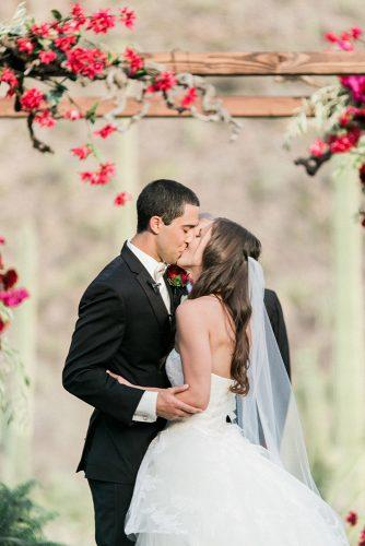 wedding photos kiss under red flower rachel solomon