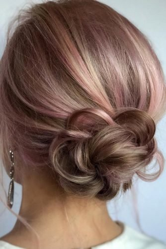 wedding updos for short hair braided bun with bangs on pink annette_updo_artist