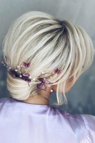 wedding updos for short hair small low bun volume textured with lilac flowers babaevski