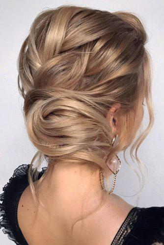 wedding updos for short hair textured low bun on blonde hair hair_vera