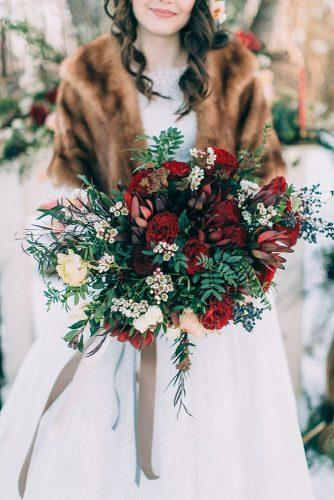 winter wedding bouquets bright bouquet with red roses and greenery emily delamater photography