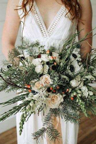 winter wedding bouquets white roses and fir branches jessica huff via instagram