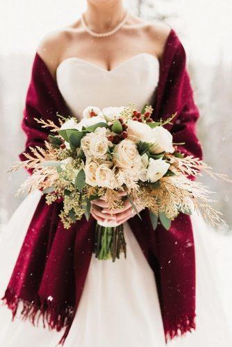 winter wedding bouquets with dry branches greenery and white roses precious image photography