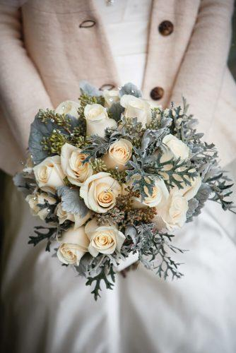 winter wedding bouquets with white roses greenery and crystals genevieve nisly photography