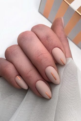 nail design nude beige with minimalistic gold stripes lyuciya_nails
