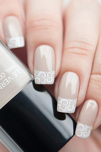 nail design on a beige background white drawings on the tips anna gorelova via instagram