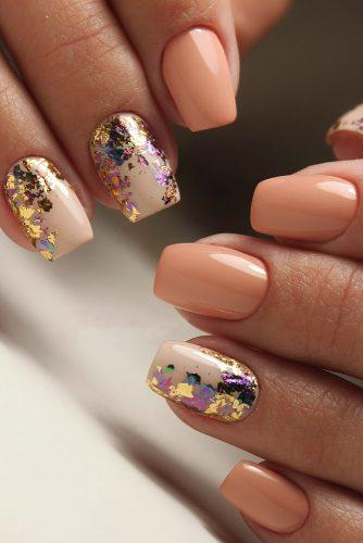 nail design pastel peach and nude with colorful foil effect masternailsira