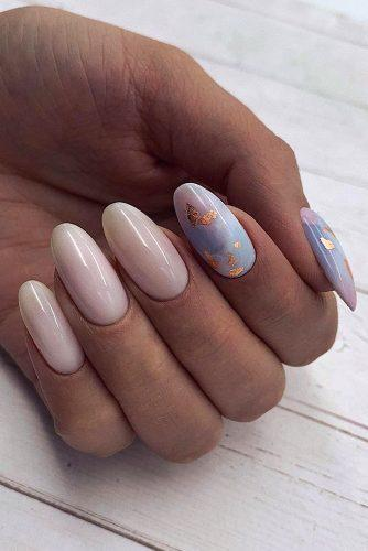 nail design pastel pink and blue with gold foil effect koba_nails_studio
