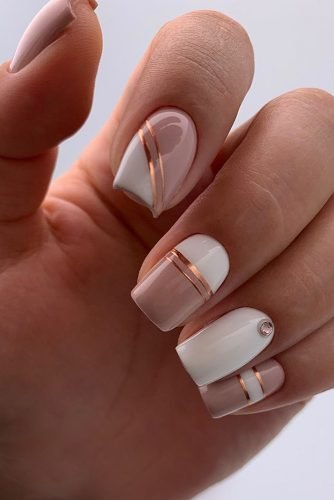 nail design pink white pink minimalist with golden stripes and rhinestones lyasha_nevskaya