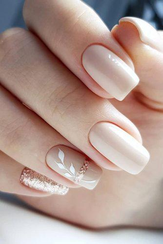 nail design wedding nude beige with white leaves and glitter gira.nails