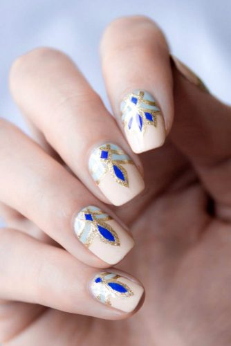 nail design with a golden blue pattern so_nailicious via instagram