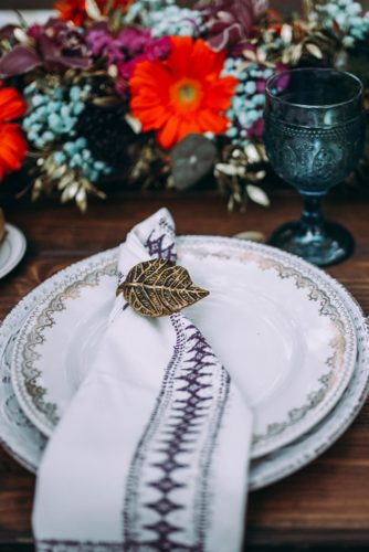 on a table with flowers a plate with indian patterns lorena erre photography