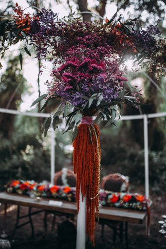 pink lilac and orange exotic flowers decorate the arbor lorena erre photography