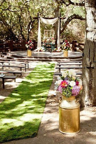rustic backyard wedding cozy ceremony decorated with flowers flower allie