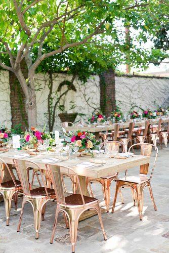 rustic backyard wedding decoration backyard reception with wooden flower table and rose gold chairs kaysha weiner