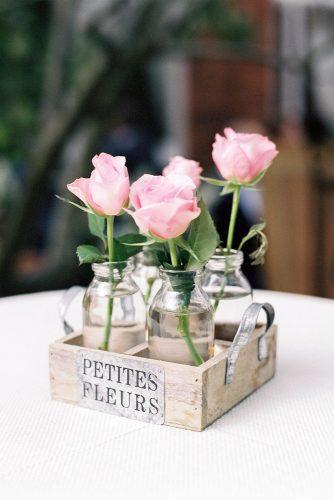 rustic backyard wedding decoration pink roses in glass jars in wooden box lucy davenport