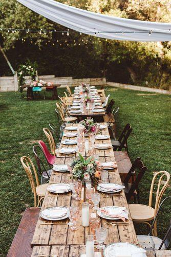 rustic backyard wedding decoration reception with long wooden table flower centerpieces steve cowell
