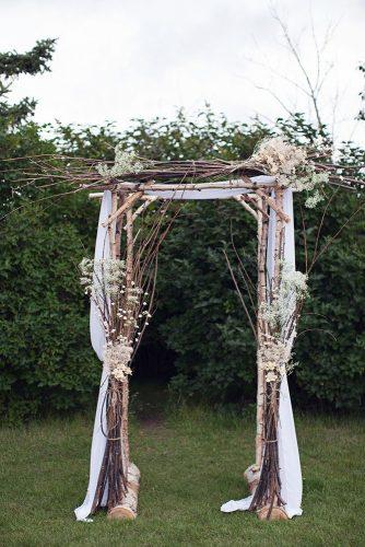 rustic backyard wedding decoration wooden arch with branches and babys breathe flowers sharon litchfield photography