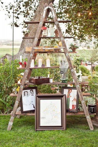 rustic backyard wedding decoration wooden ladder with flowers and photos joyful weddings and events