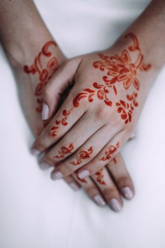 the brides hands are painted with mandy lorena erre photography
