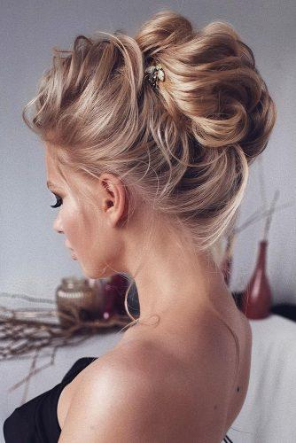 wedding hairstyles for medium hair elegant high bun on blonde hair tonyastylist