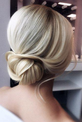 wedding hairstyles for medium hair elegant low chignon on blonde hair olesya_zemskova