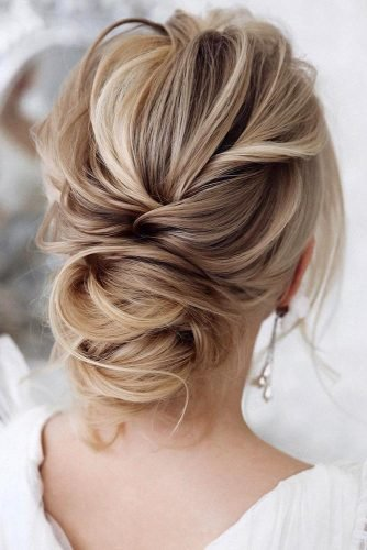 wedding hairstyles for medium hair simple elegant airy low bun on blonde hair tonyastylist