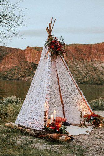 bohemian wedding ideas boho lace teepee decorated with roses and candles katherine joy photography